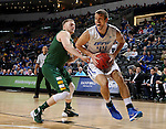 SIOUX FALLS, SD - MARCH 7:  Joe Reed #44 of Fort Wayne jumps with the ball as Dexter Werner #40 of North Dakota State defends in the 2016 Summit League Tournament.  (Photo by Dave Eggen/Inertia)