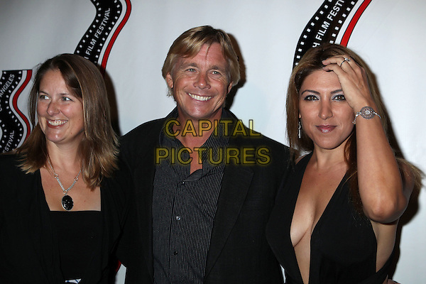 guest, Christopher Atkins, Michelle Alexandria <br /> 13th annual Polish film festival at American Cinematheque's Egyptian Theatre, Hollywood, California, USA.<br /> 9th October 2012<br /> headshot portrait black shirt suit jacket stripe cleavage hand arm <br /> CAP/ADM/RE<br /> &copy;Russ Elliot/AdMedia/Capital Pictures