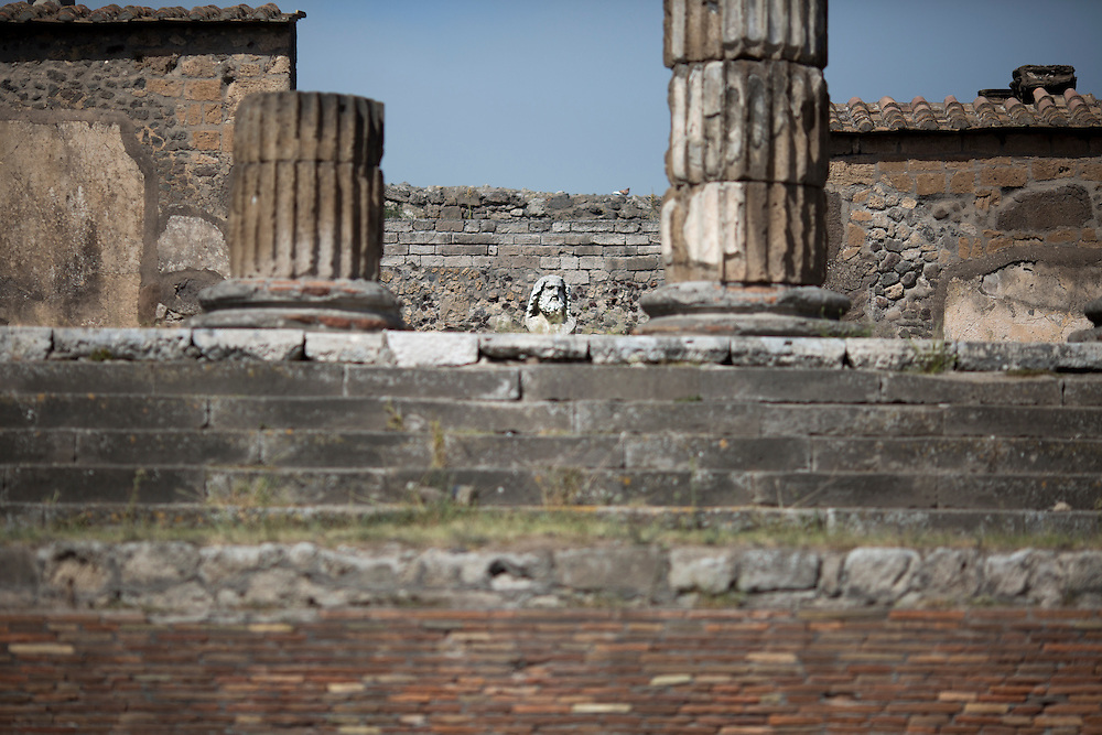 A statue of Jupiter is seen inside ruins of the Temple of Jupiter on Friday, Sept. 18, 2015, in Pompeii, Italy. The city of Pompeii was destroyed when nearby Mount Vesuvius erupted on August 24, AD 79. The town and its residents were buried and forgotten until the ruins were discovered and eventually excavated hundreds of years later. The ruins are one of Italy's top tourist attractions today. (Photo by James Brosher)