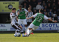 Kenny McLean (left) and George Francomb tackle watched by Thomas Soares in the St Mirren v Hibernian Clydesdale Bank Scottish Premier League match played at St Mirren Park, Paisley on 29.4.12.