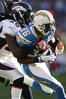 11/27/11 San Diego, CA: San Diego Chargers wide receiver Vincent Brown #86 and Denver Broncos free safety Quinton Carter #28 during an NFL game played between the Denver Broncos and the San Diego Chargers at Qualcomm Stadium. The Broncos defeated the Chargers 16-13 in OT