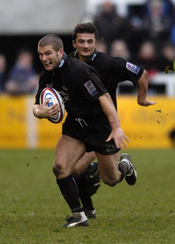 Photo. Jed Wee..Newcastle Falcons v London Wasps, Zurich Premiership, 06/02/2005..Newcastle's Tom May (L) with Adam Dehaty.