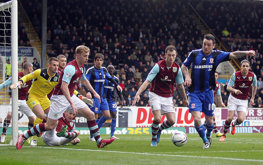 Middlesbrough&rsquo;s Lee Tomlin chases a loose ball in the Burnley penalty area following a corner<br /> <br /> Photo by Rich Linley/CameraSport<br /> <br /> Football - The Football League Sky Bet Championship - Burnley v Middlesbrough - Saturday 12th April 2014 - Turf Moor - Burnley<br /> <br /> &copy; CameraSport - 43 Linden Ave. Countesthorpe. Leicester. England. LE8 5PG - Tel: +44 (0) 116 277 4147 - admin@camerasport.com - www.camerasport.com