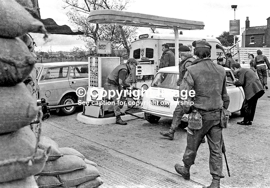 British soldiers operate a filling station in Ladas Drive, Belfast, N Ireland during the UWC Strike. 197405260782.<br /> <br /> Copyright Image from Victor Patterson, 54 Dorchester Park, <br /> Belfast, UK, BT9 6RJ<br /> <br /> t1: +44 28 9066 1296 (from Rep of Ireland 048 9066 1296)<br /> t2: +44 28 9002 2446 (from Rep of Ireland 048 9002 2446)<br /> m: +44 7802 353836<br /> <br /> e1: victorpatterson@me.com<br /> e2: victorpatterson@gmail.com<br /> www.victorpatterson.com<br /> <br /> Please see my Terms and Conditions of Use at www.victorpatterson.com. It is IMPORTANT that you familiarise yourself with them.<br /> <br /> Images used on the Internet must be visibly watermarked i.e. &copy; Victor Patterson<br /> within the body of the image and copyright metadata must not be deleted. Images <br /> used on the Internet have a size restriction of 4kbs and will be chargeable at current<br />  NUJ rates unless agreed otherwise.<br /> <br /> This image is only available for the use of the download recipient i.e. television station, newspaper, magazine, book publisher, etc, and must not be passed on to any third <br /> party. It is also downloaded on condition that each and every usage is notified within 7 days to victorpatterson@me.com<br /> <br /> The right of Victor Patterson to be identified as the author is asserted in accordance with The Copyright Designs And Patents Act (1988).