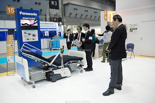 October 17, 2012, Tokyo, Japan - Visitors see the new Panasonic Roboticbed at Japan Robot Week. The Japan Robot Week 2012 shows the New Energy and Industrial Robot Innovation Technology products in Japan, the exhibition opens from October 17 to 19 at Tokyo Big Sight. (Photo by Rodrigo Reyes Marin/AFLO)..