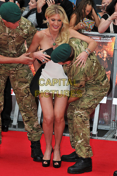 Hofit Golan.The 'The Expendables 2' UK film premiere, Empire cinema, Leicester Square, London, England..August 13th, 2012.full length black white strapless dress lifting carrying holding army camouflage gesture green.CAP/BF.©Bob Fidgeon/Capital Pictures.