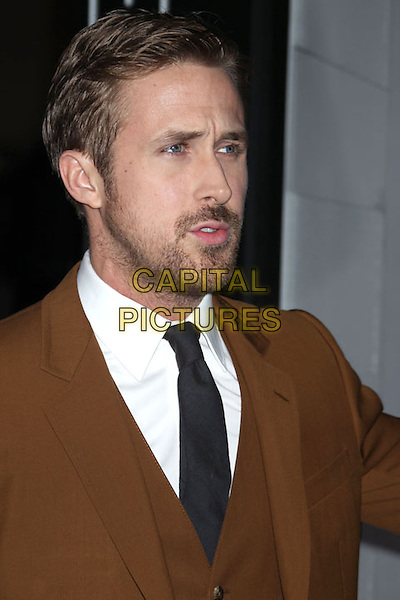 "Ryan Gosling.""Gangster Squad"" premiere at Grauman's Chinese Theatre, Hollywood, California, USA..January 7th, 2013.headshot portrait white shirt beard facial hair brown camel suit black tie tie mouth open looks angry upset.CAP/ADM/RE.©Russ Elliot/AdMedia/Capital Pictures."