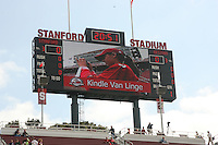 14 October 2006: Kindle Van Linge, the HP Junior Photographer marketing winner, watches herself on the scoreboard during Stanford's 20-7 loss to Arizona during Homecoming at Stanford Stadium in Stanford, CA.