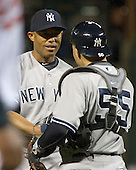 New York Yankees pitcher Mariano Rivera (42), left and catcher Russell Martin (55), right, congratulate each other after their team's 6 -4 victory over the Baltimore Orioles at Oriole Park at Camden Yards in Baltimore, MD on Wednesday, April 11, 2012.  .Credit: Ron Sachs / CNP.(RESTRICTION: NO New York or New Jersey Newspapers or newspapers within a 75 mile radius of New York City)