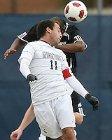 Jose Colchao #11 of Georgetown University heads past David Datilus #2 of Providence University during a Big East quarter-final  match at North Kehoe Field, Georgetown University on November 6 2010 in Washington D.C. Providence won 2-1.