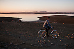 FOLSOM, CA - JANUARY 15, 2014: A visitor rides on the dry lakebed of Folsom Lake reservoir, which has dropped to 18% capacity as an unseasonably dry winter in California stokes fears of a severe drought. CREDIT: Max Whittaker for The New York Times