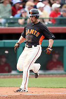 Andres Torres #56 of the San Francisco Giants bats scores a run against the Arizona Diamondbacks in the first spring training game of the season at Scottsdale Stadium on February 25, 2011  in Scottsdale, Arizona. .Photo by:  Bill Mitchell/Four Seam Images.