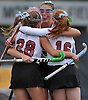 Garden City No. 9 Devon Heaney, center (face visible), celebrates with teammates after a goal by No. 28 Emily Clarke extended the Trojans' lead over Manhasset to 3-0 in the first half of the Nassau County varsity field hockey Class B final at Adelphi University on Sunday, November 1, 2015. Garden City went on to win by a score of 9-0.<br /> <br /> James Escher