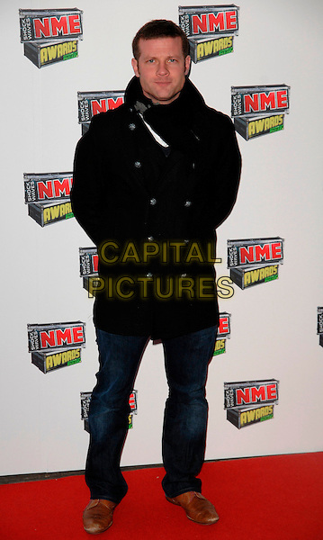 DERMOT O'LEARY.Attends The Shock Waves NME Awards 2007 at Hammersmith Palais, London, England, 1st March 2007..Full length music magazine band black coat scarf jeans brown shoes.CAP/CAN.©Can Nguyen/Capital Pictures