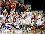 VERMILLION, SD, APRIL 2:  The University of South Dakota celebrates a during a time out in the fourth quarter against Florida Gulf Coast during the WNIT Championship game Saturday afternoon at the Dakota Dome in Vermillion, S.D. (Photo by Dave Eggen/Inertia)