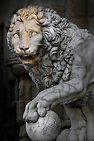 Detail of sculpture of Lion, 1600, by Flaminio Vacca or Vacchi (1538-1605), Florence, Italy, pictured on 9 June 2007 in the late afternoon. The lion was made to match a Roman sculpture which originally stood by the staircase at the Villa Medici. When the Villa was sold by the Grand Duke of Tuscany the lions were moved to the Piazza della Signoria, Florence, where they flank the steps to the Loggia dei Lanzi. Picture by Manuel Cohen