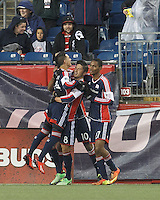 New England Revolution midfielder Diego Fagundez (14) celebrates his goal with teammates.  In a Major League Soccer (MLS) match, the New England Revolution (blue) defeated Toronto FC (red), 2-0, at Gillette Stadium on May 25, 2013.
