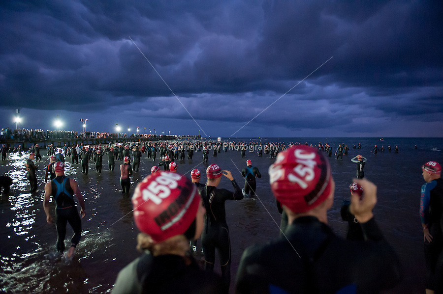 Competitors wade into the water for the swim leg of the Ironman Asia Pacific Championship in Melbourne, Australia. Photo Sydney Low..This image is not for sale on this web site. Please contact ZUMApress.com for licensing:.Phone +1.949.481.3747  -  fax +1.949.481.3941  -  zuma-info@ZUMAPress.com .408 N. El Camino Real, San Clemente, California, 92672 USA