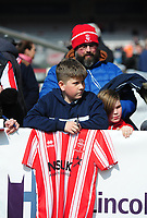 Lincoln City fans enjoy the pre-match atmosphere<br /> <br /> Photographer Andrew Vaughan/CameraSport<br /> <br /> The EFL Sky Bet League Two - Lincoln City v Cheltenham Town - Saturday 13th April 2019 - Sincil Bank - Lincoln<br /> <br /> World Copyright &copy; 2019 CameraSport. All rights reserved. 43 Linden Ave. Countesthorpe. Leicester. England. LE8 5PG - Tel: +44 (0) 116 277 4147 - admin@camerasport.com - www.camerasport.com