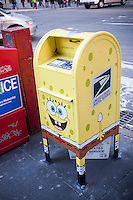"A Nickelodeon ""SpongeBob MailPants"" branded USPS mailbox is seen in midtown Manhattan in New York on Wednesday, December 11, 2013. The mailbox. decorated with the renamed SpongeBob SquarePants cartoon character, is part of a promotion to engage children in writing, sending and receiving mail for the holiday season.(© Richard B. Levine)"