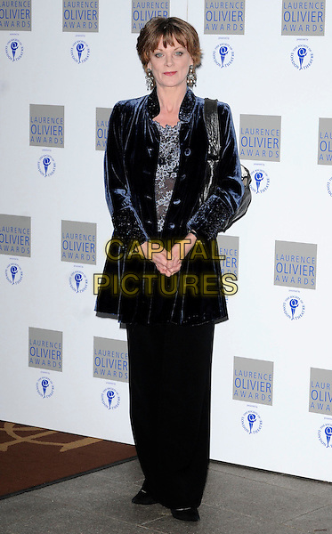SAMANTHA BOND .The Laurence Olivier Awards 2010, Grosvenor House Hotel, London, England. .21st March 2010.full length black trousers blue velvet jacket.CAP/CAN.©Can Nguyen/Capital Pictures.