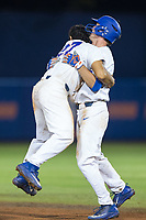 Nelson Maldonado (27) of the Florida Gators jumps into the arms of teammate Ryan Larson (66) after Larson's walk-off hit against the Wake Forest Demon Deacons in Game One of the Gainesville Super Regional of the 2017 College World Series at Alfred McKethan Stadium at Perry Field on June 10, 2017 in Gainesville, Florida.  The Gators defeated the Demon Deacons 2-1 in 11 innings.  (Brian Westerholt/Four Seam Images)