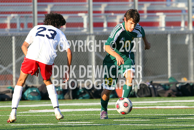 Redondo Beach, CA 02/01/10 - Augie Diaz (Mira Costa #13) and Ruben Pereida (Redondo Union #23) in action during the Bay League Boys Varsity Soccer game between Mira Costa and Redondo Union.