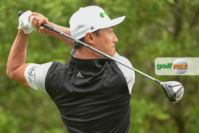 HaoTong Li (CHN) watches his tee shot on 1 during day 3 of the Valero Texas Open, at the TPC San Antonio Oaks Course, San Antonio, Texas, USA. 4/6/2019.<br /> Picture: Golffile | Ken Murray<br /> <br /> <br /> All photo usage must carry mandatory copyright credit (© Golffile | Ken Murray)