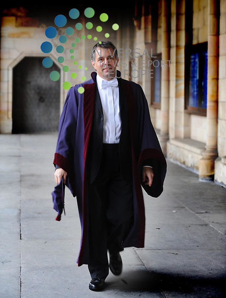 NEWLY INSTALLED RECTOR AT ST ANDREWS UNIVERSITY KEVIN DUNION OBE TAKES A WAK THROUGH THE CLOISTERS AT THE FAMOUS QAUDRANGLE Picture: Universal News and Sport 3/3/09. All pictures must be credited to  www.universalnewsandsport.com.(0ffice) 0844 884 51 22