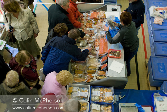 Shoppers browsing and buying produce at the Wirral Farmers' Market at New Ferry, Wirral. The market was established six years ago and is held on a Saturday each month at New Ferry Village Hall. Producers come from accross the north west of England to sell their produce.
