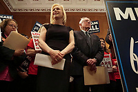 """United States Senator Kirsten Gillibrand (Democrat of New York), center, joins US Senator Bernie Sanders (Independent of Vermont), left, and US Senator Ed Markey (Democrat of Massachusetts), right, as Sanders announces he has introduced a new version of his """"Medicare for All"""" plan at a press conference on Capitol Hill in Washington DC on April 10, 2019.  The Sanders plan will replace job-based and private health insurance with a government plan that guarantees coverage, including long-term care, for all citizens. Photo Credit: Stefani Reynolds/CNP/AdMedia"""