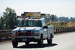 Ford work truck with brush guard, ladders and ladder rack.