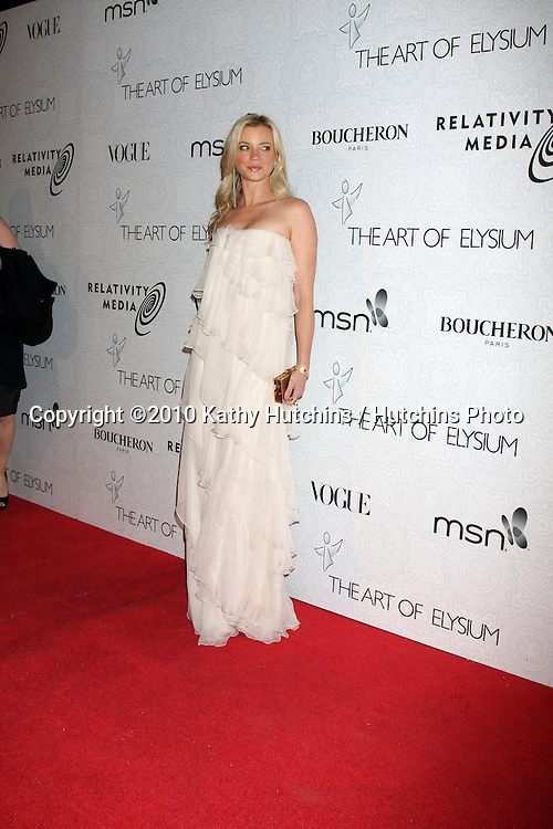Amy Smart.arriving at the 3rd Annual Art of Elysium Gala.Rooftop of Parking Garage across from Beverly Hilton Hotel.Beverly Hills, CA.January 16, 2010.©2010 Kathy Hutchins / Hutchins Photo....