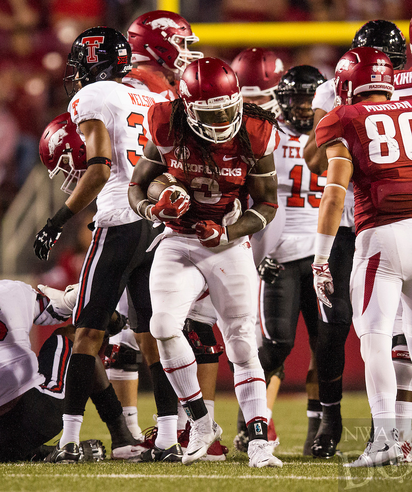 Arkansas Democrat-Gazette/MELISSA SUE GERRITS - 09/19/15 - Arkansas Razorbacks'  Alex Collins celebrates a first down during their push to survive the game in the 4th quarter against Texas Tech September 19, 2015 at Donald W. Reynolds Razorbacks Stadium in Fayetteville.