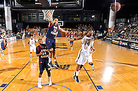 25 February 2012:  FIU guard DeJuan Wright (14) reaches for a loose ball while South Alabama guard-forward Mychal Ammons (13) collides with guard-forward Antione Lundy (34) in the first half as the FIU Golden Panthers defeated the University of South Alabama Jaguars, 81-74, at the U.S. Century Bank Arena in Miami, Florida.