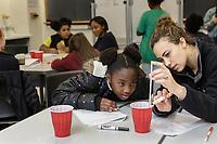 Ashley Williams, 10, is mentored by Duke student Hannah Berg during a  Duke FEMMES STEM mentoring program at Duke University in Durham, North Carolina, Saturday, February 9, 2019  (Justin Cook)