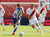 Rayo Vallecano's Alejandro Galvez (r) and Real Sociedad's Xabi Prieto during La Liga match.April 14,2013. (ALTERPHOTOS/Acero)