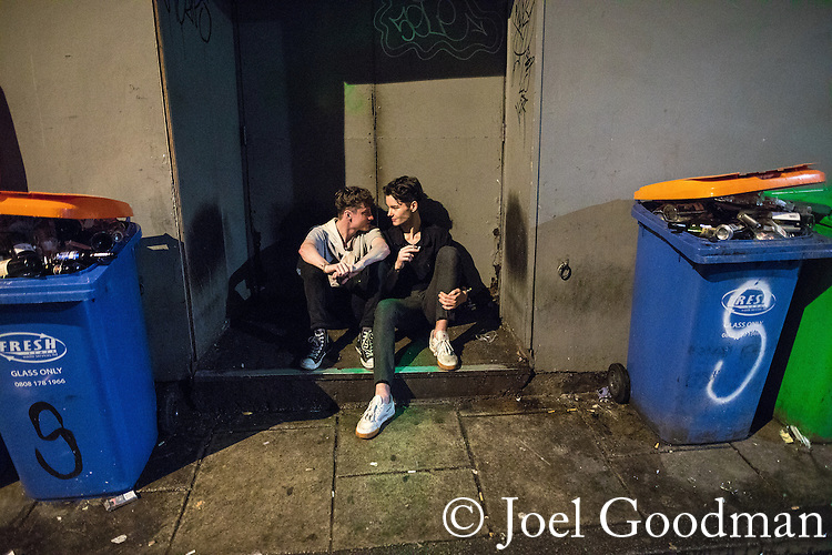 "© Joel Goodman - 07973 332324 . 17/12/2016 . Manchester , UK . Two men sit in a doorway in an alleyway off Peter Street . Revellers out in Manchester City Centre overnight during "" Mad Friday "" , named for being one of the busiest nights of the year for the emergency services in the UK . Photo credit : Joel Goodman"