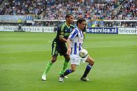 VOETBAL: HEERENVEEN: Abe Lenstra Stadion, 02-09-2012, Eredivisie 2012-2013, SC Heerenveen - Ajax, Eindstand 2-2, Ricardo van Rhijn (#24 | Ajax), Daniel de Ridder (#6 | SCH), ©foto Martin de Jong