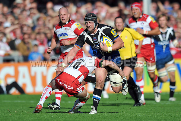 Carl Fearns is tackled by Freddie Burns. Aviva Premiership match, between Gloucester Rugby and Bath Rugby on October 6, 2012 at Kingsholm Stadium in Gloucester, England. Photo by: Patrick Khachfe / Onside Images