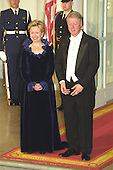 United States President Bill Clinton, left, and first lady Hillary Rodham Clinton, stand on the North Portico of the White House in Washington, D.C. awaiting the arrival of King Juan Carlos I and Queen Sofia of Spain for a State Dinner on February 23, 2000.<br /> Credit: Ron Sachs / CNP
