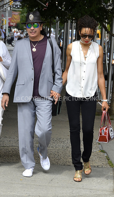 WWW.ACEPIXS.COM . . . . .  ....July 27, 2012, New York City....Carlos Santana and Cindy Blackman strolling in SoHo, on July 27, 2012 in New York City.....Please byline: CURTIS MEANS - ACE PICTURES.... *** ***..Ace Pictures, Inc:  ..Philip Vaughan (212) 243-8787 or (646) 769 0430..e-mail: info@acepixs.com..web: http://www.acepixs.com
