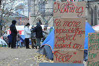 November 21, 2011, unidentified protesters discuss matters today at St. James Park Toronto following the decision handed down this morning by Ontario Superior Court judge David Brown, upholding the Occupy Toronto tent camp eviction.  A hand painted sign, right quotes Albert Camus.