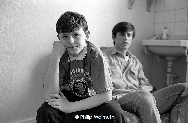 Cousins Tahir Selmani (13) and Durim Kadiu (18) in a KIngs Cross hotel room after fleeing from their burnt out homes in Djakovice (Gjakove), Kosovo.