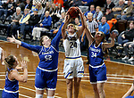 SIOUX FALLS, SD - NOVEMBER 15: South Dakota State Jackrabbits's Tagyn Larson #24 takes the ball to the basket between Jessica Mieras #52 and Matti Reiner #34 from Dakota Wesleyan during their game Friday evening at the Sanford Pentagon in Sioux Falls, SD. (Photo by Dave Eggen/Inertia)
