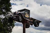 "An antique truck raised 20 or 30 feet in the air announces, ""Art Robinson's Antique Trucks for View"" where US Route 50 leaves Salinas, Utah, heading west."
