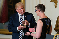 United States President Donald J. Trump presents National Teacher of The Year, Mandy Manning of Washington, the National Teacher of The Year award during a ceremony in the East Room of the White House in Washington, DC n May 2, 2018. Credit: Alex Edelman / CNP /MediaPunch