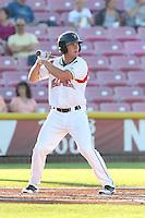 Shilo McCall #18 of the Salem-Keizer Volcanoes bats against the Spokane Indians at Volcanoes Stadium on July 26, 2014 in Keizer, Oregon. Spokane defeated Salem Keizer, 4-1. (Larry Goren/Four Seam Images)