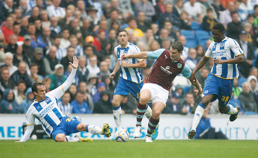 Burnley's Sam Vokes (2nd R) in action against Brighton &amp; Hove Albion's Rohan Ince (R) and David Lopez (L)<br /> <br /> (Photo by Jack Phillips/CameraSport)<br /> <br /> Football - The Football League Sky Bet Championship - Brighton and Hove Albion v Burnley - Saturday 24th August 2013 - American Express Community Stadium - Brighton<br /> <br /> &copy; CameraSport - 43 Linden Ave. Countesthorpe. Leicester. England. LE8 5PG - Tel: +44 (0) 116 277 4147 - admin@camerasport.com - www.camerasport.com
