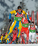 2/21/06 -- The 2006 Torino Winter Olympics -- Cesana San Sicario , Italy. -- 4 X 7.5 km biathlon -- .Racers Andriy Deryzemlya of the Ukraine, front, Stian Eckhoff of Norway, middle, and Vincent Defrasne, right, race up the first hill after the relay handoff during the men's 4 x 7.5 km biathlon in San Sicario, Italy..Photo by Scott Sady, USA TODAY staff.